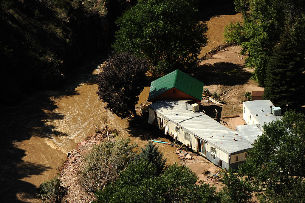 . Flood damage as seen from a UH-60 Black Hawk during search grid flights of the foothills west of Boulder by members of the 2-4 GSAB with the 4th ID of Fort Carson September 17, 2013 Boulder, CO. (Photo By Joe Amon/The Denver Post)