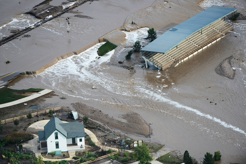 . Flood waters cut in-between a house and a stadium in Loveland Colorado Saturday morning, September 14, 2013. (Photo By Andy Cross/The Denver Post)