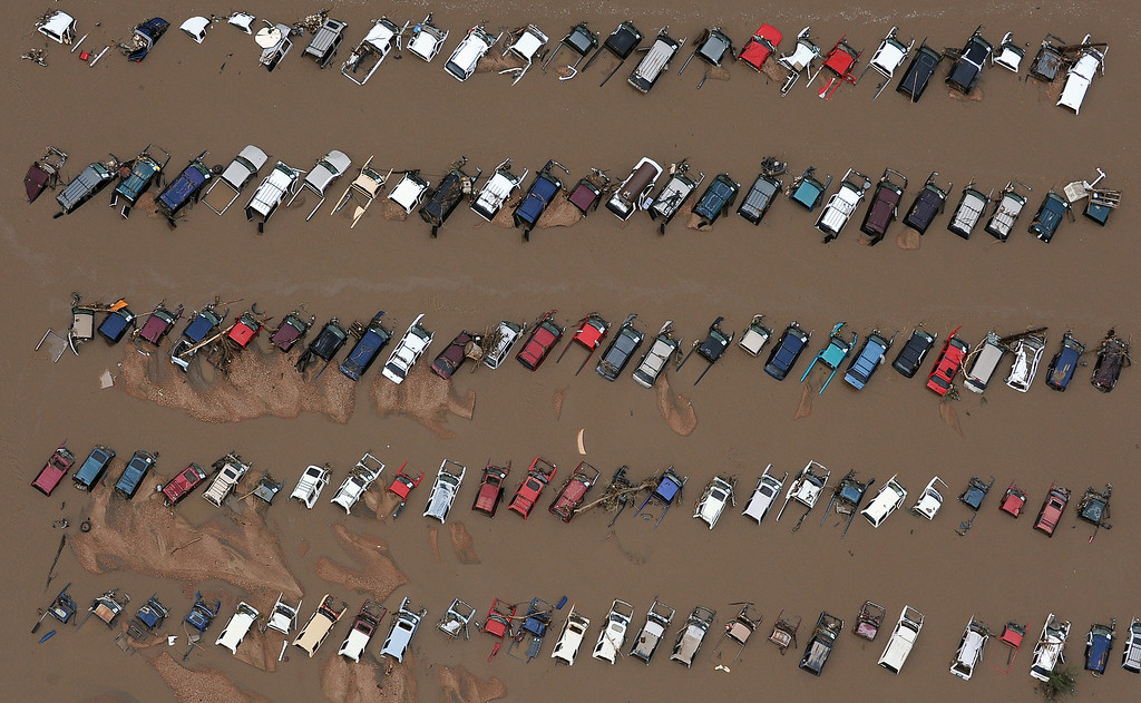 . Cars in a junk yard on 37th Street in Evans,  Colorado, are surrounded by mud and flood waters from the Platte River in Weld County on Monday, September 16, 2013. The flood has devastated cities and farms throughout the county as well as elsewhere in the state. (Photo By Tim Rasmussen/The Denver Post)