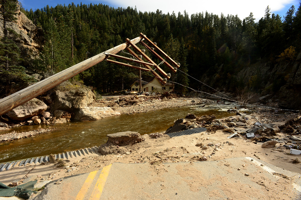 . GLEN HAVEN, CO - SEPTEMBER 30: Main street or Co Road 43 going through the town of Glen Haven, CO is completely gone on September 30, 2013. The road, which literally ends here,  is over 85% destroyed all the way down to Drake which is 8 miles down the road.   (Photo By Helen H. Richardson/ The Denver Post)