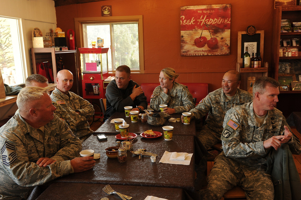 . Members of the Colorado National Guard from Buckley Air Force base enjoy cherry pie and other delicacies at The Colorado Cherry Company in Pinewood Springs, Co on November 4, 2013.  The Colorado Cherry Company held a pie party for everyone in the community including highway workers and national guardsman to celebrate the reopening of Highway 36 through their community as  well as their first official day of reopening their restaurant.  Owners Kristi and Anthony Lehnert didn\'t charge a single person all day for any of the food that they ate.  (Photo By Helen H. Richardson/ The Denver Post)