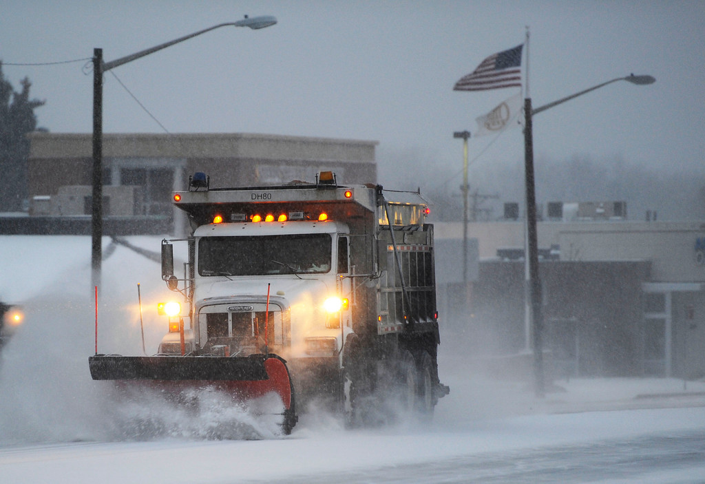 . A snow plow works Colorado Blvd near Yale Ave Thursday morning, November 21, 2013. (Photo By Andy Cross/The Denver Post)
