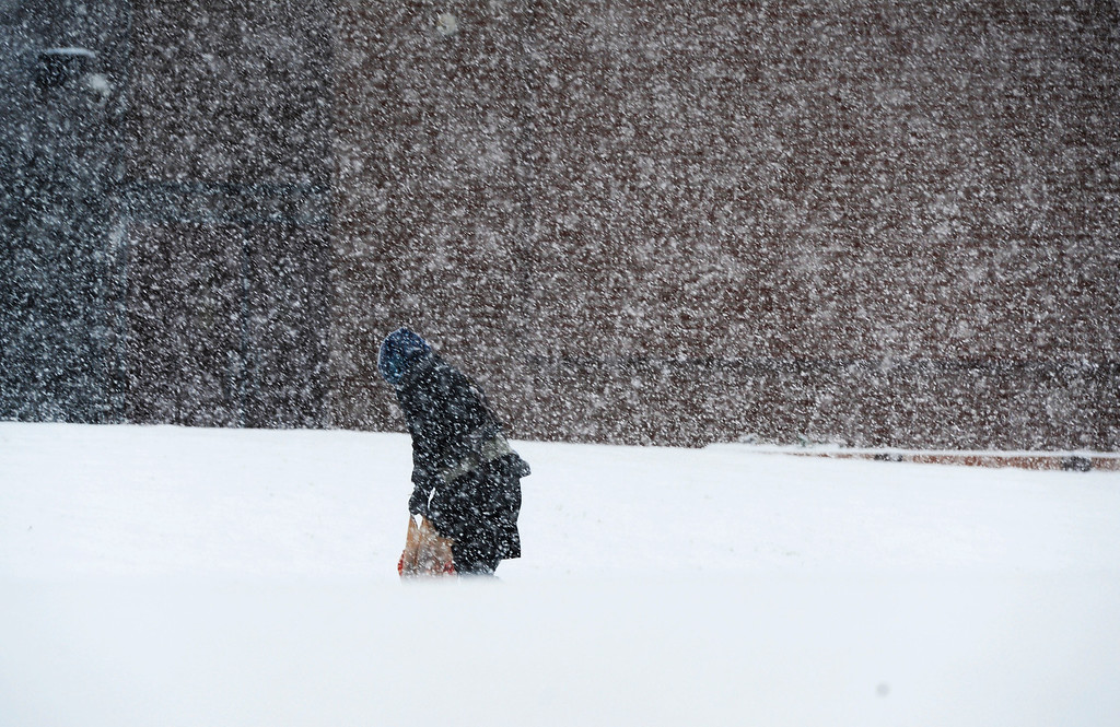 . A Denver School of the Arts student makes their way up to the school in a heavy snowstorm Thursday morning, November 21, 2013. (Photo By Andy Cross/The Denver Post)
