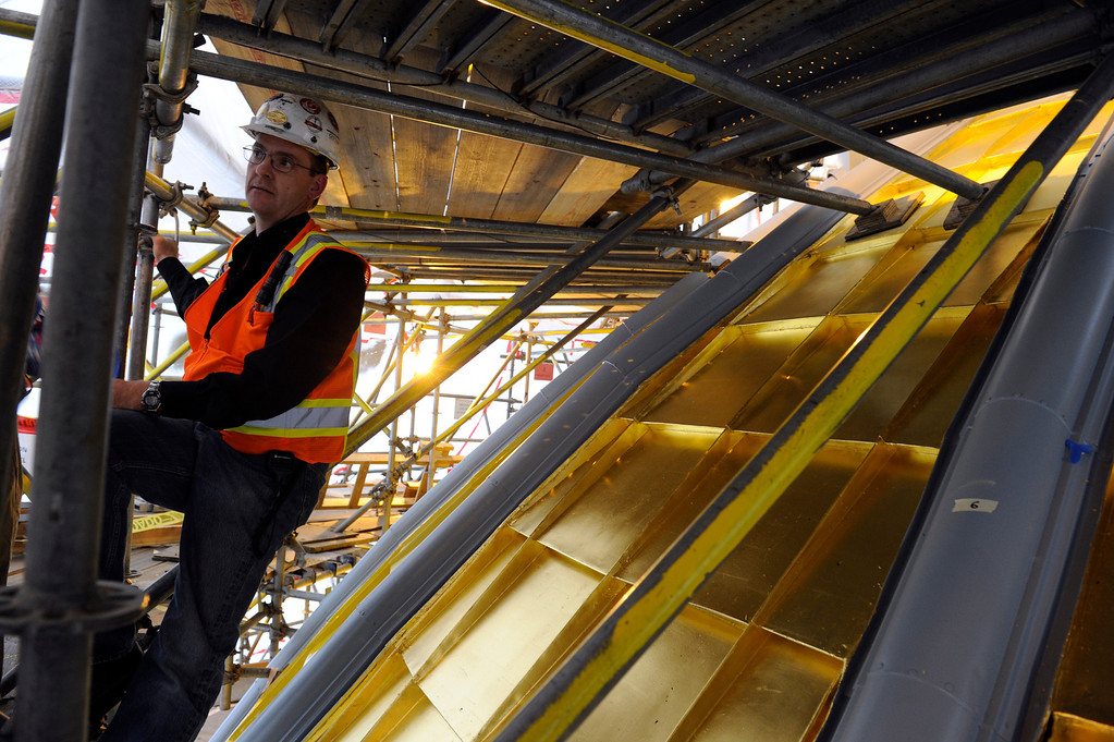 . Chris Derington Superintendent for GH Phipps Construction Companies, stands on the scaffolding near the very top of the dome Friday, November 22, 2013.  (Photo by Kathryn Scott Osler/The Denver Post)