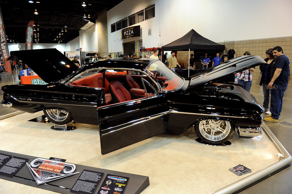 . A 1961 Chevy Impala is on display during the O\'Reilly Auto Parts Creme de la Chrome Rocky Mountain Auto Show takes place at the Colorado Convention Center downtown which runs through Sunday, Dec. 1, 2013. (Photo by Kathryn Scott Osler/The Denver Post)