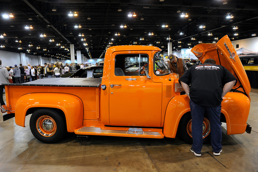 . Folks check out a 1956 Ford F100 Truck during the O\'Reilly Auto Parts Creme de la Chrome Rocky Mountain Auto Show takes place at the Colorado Convention Center downtown which runs through Sunday, Dec. 1, 2013. (Photo by Kathryn Scott Osler/The Denver Post)