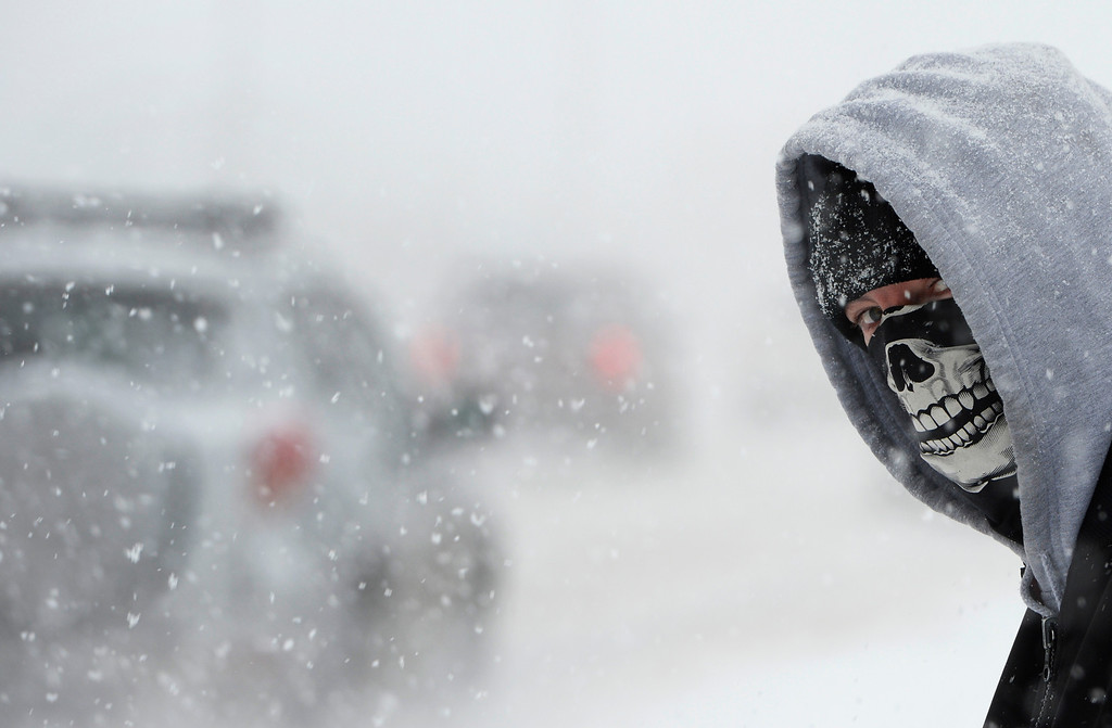 . David Trujillo waits for a bus to work, in bone chilling temperatures, in Lakewood, December 04, 2013. A larger winter storm has moved into much of Colorado bringing freezing temperatures and snow. (Photo by RJ Sangosti/The Denver Post)