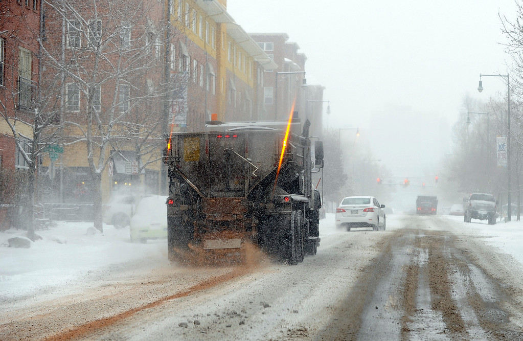. A blast of cold and snow came to Colorado on  Wednesday, December 4, 2013. A Denver snow plow deposits de-icing product on 19th Ave. near downtown Denver.  (Photo By Cyrus McCrimmon/The Denver Post)
