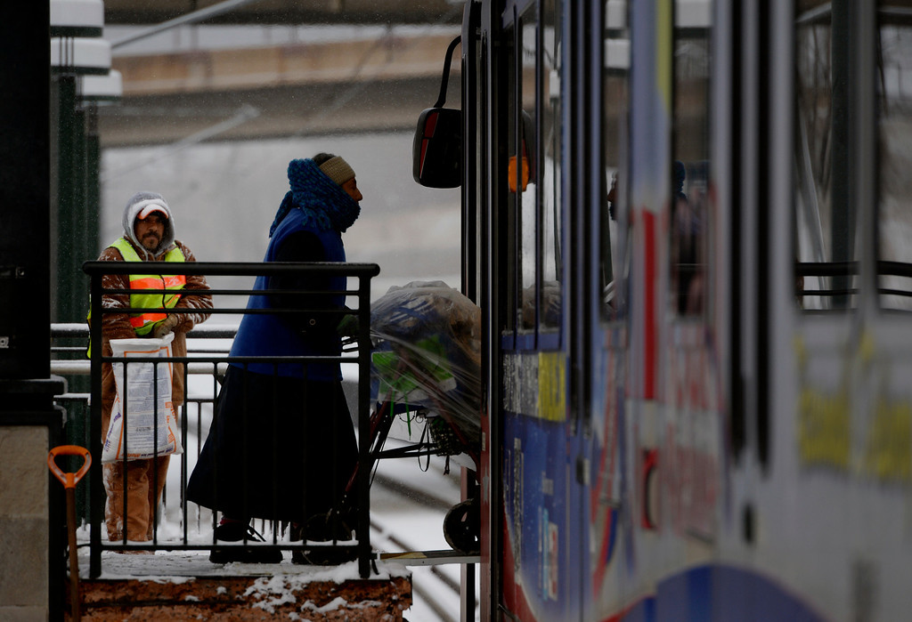 . LITTLETON, CO. - JANUARY 04: A woman boards a train at the Light Rail station in downtown Littleton, CO January 04, 2014. Temperatures will linger in the low 20s Saturday as a storm drops anywhere from 3 to 5 inches of snow in the Denver metro area, forecasters say.(Photo By Craig F. Walker / The Denver Post)
