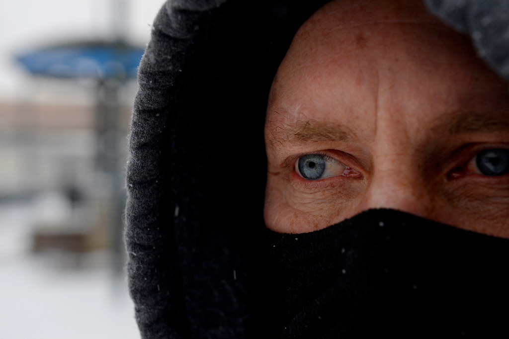 . Tim Denbeste waits for Light Rail at the RTD station in Littleton, CO January 04, 2014. Temperatures will linger in the low 20s Saturday as a storm drops anywhere from 3 to 5 inches of snow in the Denver metro area, forecasters say.(Photo By Craig F. Walker / The Denver Post)