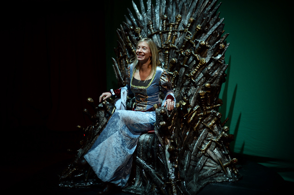 ". Sarah Finley sits on the chair from HBO\'s Game of Thrones at Paramount Theater Denver. Denver, Colorado. March 27. 2014. HBO hosted a party downtown Denver for fans of the popular series ""Game of Thrones.\"" Fans are invited to come celebrate the series - in costume - before the fourth season begins.(Photo by Hyoung Chang/The Denver Post)"