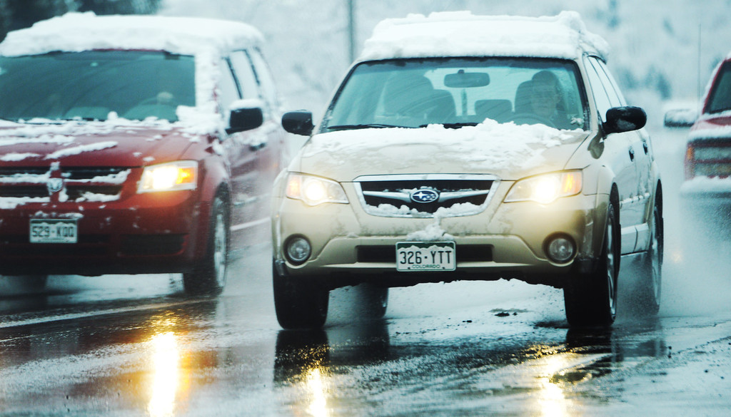 . It was a wet morning drive as snow continues to fall in Arvada, Thursday, April 03, 2014. The Denver area was hit with a spring snow storm overnight.(Photo by RJ Sangosti/The Denver Post)