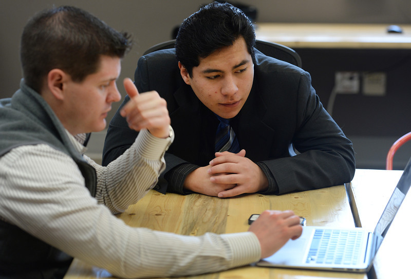 . Former foster care kid Diego Conde, 18, sits with Pat McClary, right, director of professional development for SeedPaths in Denver, on March 21, 2014. Conde lost his mother in 2008 when he was only 12 years old. (Photo By Helen H. Richardson/ The Denver Post)