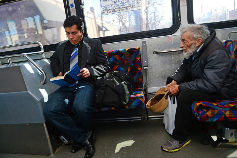 . Former foster care kid Diego Conde, 18,  left, loves to read and takes every opportunity while sitting on one of 6 buses that he took during a recent busy day in Denver, on March 21, 2014. Conde lost his mother in 2008 when he was only 12 years old. (Photo By Helen H. Richardson/ The Denver Post)