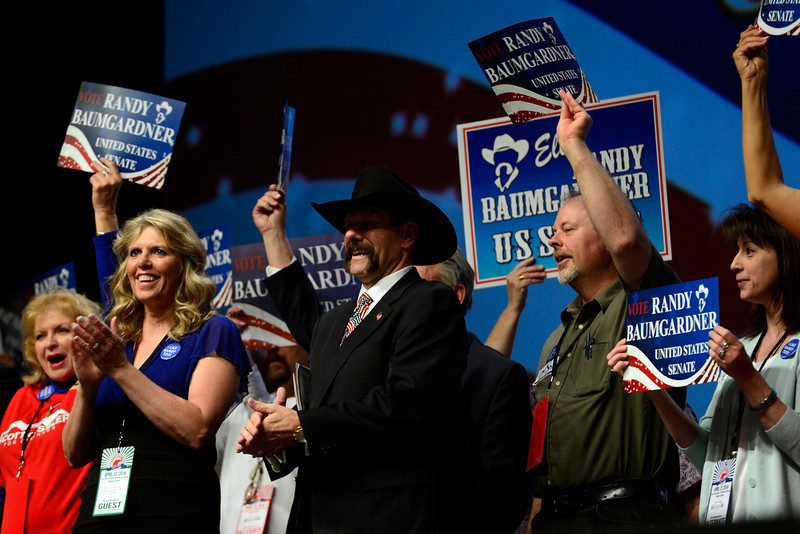 . Randy Baumgardner, center in cowboy hat, stands with his supporters as he makes his case to be a Republican candidate on the ballot for the United State Senate. The Colorado Republican Party holds its state assembly for statewide candidates running for office at the Coors Event Center on the University of Colorado campus in Boulder. (Kathryn Scott Osler, The Denver Post)