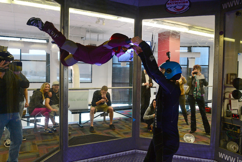 . Max Vertin, 8,  of Hastings, Nebraska, enjoys flying through the air in the wind tunnel at SkyVenture Colorado indoor sky diving with the help of instructor Josh Evans in Lone Tree, Co  on April 15, 2014. (Photo By Helen H. Richardson/ The Denver Post)