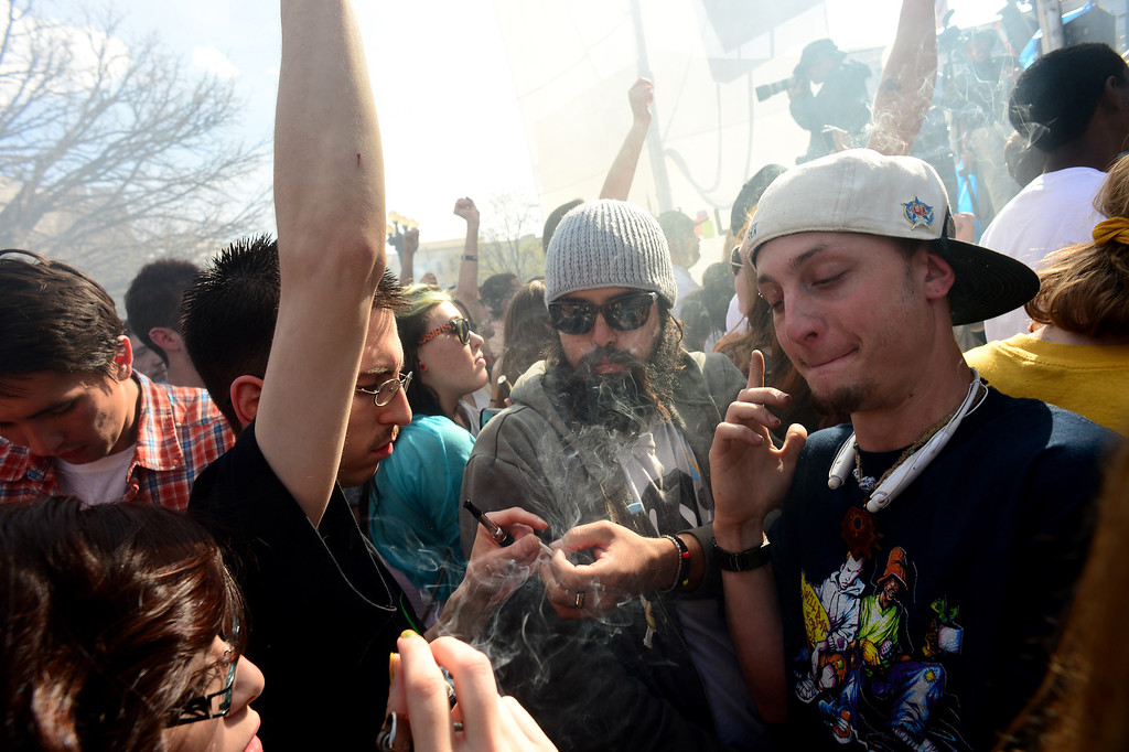 . Thousands of people lit up joints, bongs, pipes and marijuana cigarettes at exactly 4:20 pm during the Colorado 420 Rally at Civic Center Park in Denver on April 20, 2014.  Thousands of people lit up and smoked marijuana to celebrate the now legal use of marijuana in the state of Colorado.  (Photo By Helen H. Richardson/ The Denver Post)