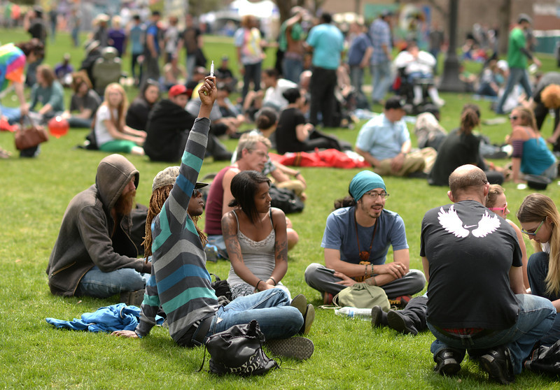 . People celebrate the first day of the 420 Rally weekend in Civic Center Park, Denver, Colorado, April 19, 2014. (Photo by Hyoung Chang/The Denver Post)