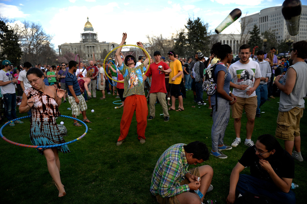 . Don Blosser, 22, of Denver (center of the photo) continues to celebrate after the smoke out at the 420 celebration at the Denver 420 Rally in Civic Center Park April 20, 2014 Denver, CO (Photo By Joe Amon/The Denver Post)
