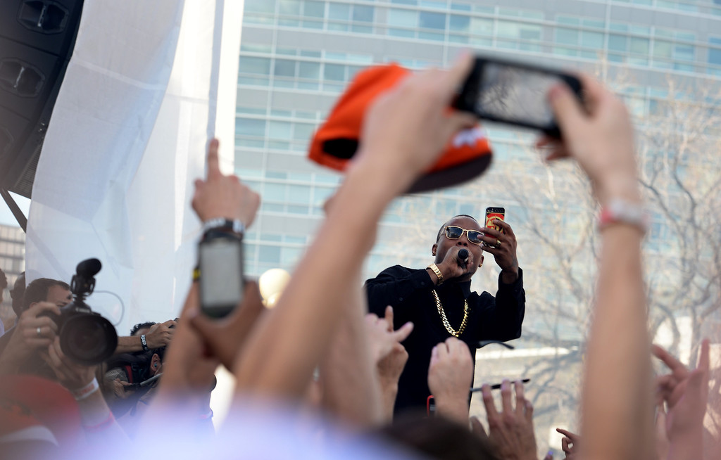 . Rap singer B.o.B. takes pictures with a cell phone as he performed for thousands during the Colorado 420 Rally at Civic Center Park in Denver on April 20, 2014.  Thousands of people lit up marijuana pipes, cigarettes, joints, and bongs at exactly 4:20 pm to celebrate the now legal use of marijuana in the state of Colorado.  (Photo By Helen H. Richardson/ The Denver Post)