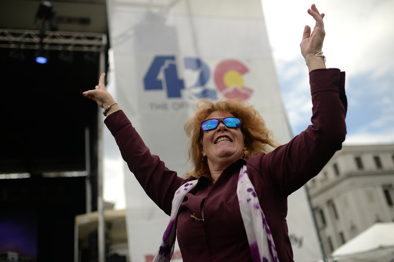 . Tamara Starpayseno of Denver is celebrating with the dance during the first day of the 420 Rally weekend in Civic Center Park, Denver, Colorado, April 19, 2014. (Photo by Hyoung Chang/The Denver Post)