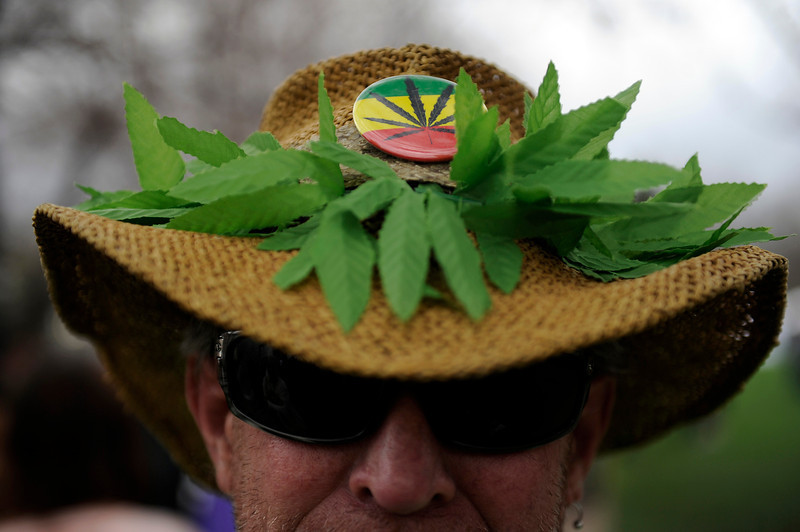 ". ""Chaz\"" shows off his marijuana themed hat during the 420 Rally at Civic Center Park in Denver, Colorado on April 19, 2014. (Photo by Seth McConnell/The Denver Post)"