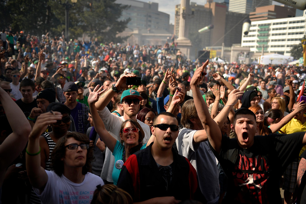 . Marijuana smoke fills the air at 4:20 pm during the 420 celebration at the Denver 420 Rally in Civic Center Park April 20, 2014 Denver, CO (Photo By Joe Amon/The Denver Post)