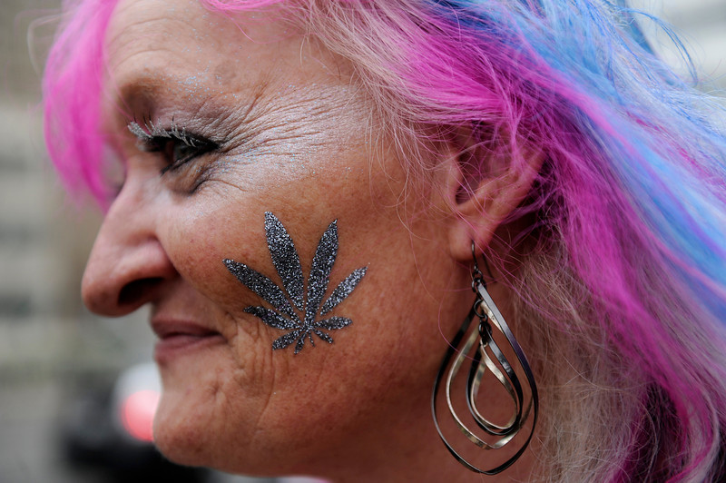 . A glittery pot leaf adorns the cheek of an attendee during the 420 Rally at Civic Center Park in Denver, Colorado on April 19, 2014. (Photo by Seth McConnell/The Denver Post)