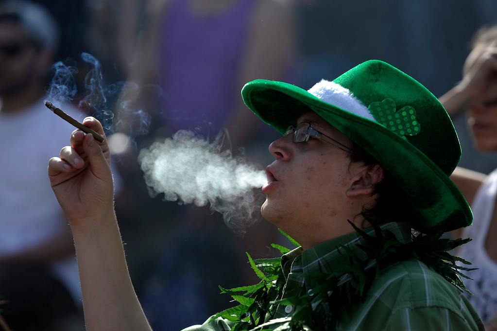 . A man smokes a blunt as the clock strikes 4:20 during the 420 Rally at Civic Center Park in Denverlorado on April 20, 2014. (Photo by Seth McConnell/The Denver Post)