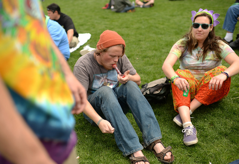 . Kyle Capron from Flagstone, TX is smoking marijuana during the first day of the 420 Rally weekend in Civic Center Park, Denver, Colorado, April 19, 2014. (Photo by Hyoung Chang/The Denver Post)