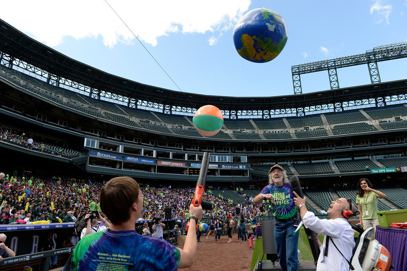 . Colorado State University�s Little Shop of Physics attempt to set a Guinness World Record for the largest physics lesson during the fifth annual Weather and Science Day at Coors Field, April 23, 2014. Brian Jones, center, CSU physics instructor and director of the Little Shop of Physics, leads over 10,000 students  during the hour-long interactive science lesson. (Photo by RJ Sangosti/The Denver Post)