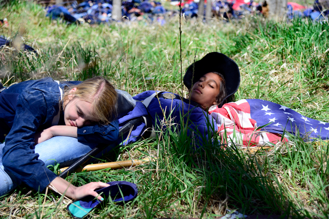 . Students pretending to be Union soldiers play dead as 400 hundred eighth-grade students from the Adams 12 School District reenact scenes from the Battle of Spotsylvania and the Battle of Cold Harbor during Century Middle School\'s annual Civil War Reenactment at Lake Village Park in Thornton on Thursday, April 24, 2014. �You Can Live History,� a Colorado-based nonprofit, provided authentic uniforms and weaponry and filmed the battles. (Photo By Lindsay Pierce/The Denver Post)