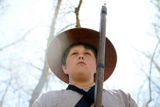 . C.J. Kershner, plays a Confederate soldier waiting for battle as 400 eighth-grade students from the Adams 12 School District reenact scenes from the Battle of Spotsylvania and the Battle of Cold Harbor during Century Middle School\'s annual Civil War Reenactment at Lake Village Park in Thornton on Thursday, April 24, 2014. �You Can Live History,� a Colorado-based nonprofit, provided authentic uniforms and weaponry and filmed the battles. (Photo By Lindsay Pierce/The Denver Post)
