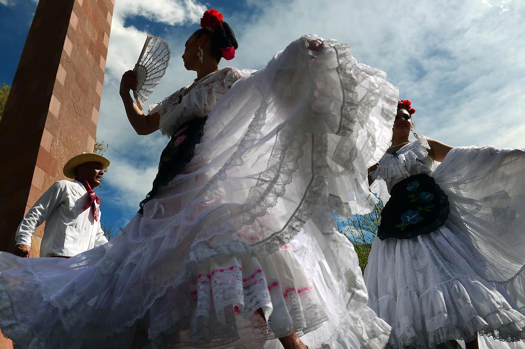 . Dancers with Fiesta Colorado Colorado Dance Company perform the Un Fandango en Veracruz dance during the Cinco de Mayo celebrations at Civic Center Park in Denver, CO on May 24 2014. (Photo By Helen H. Richardson/ The Denver Post)