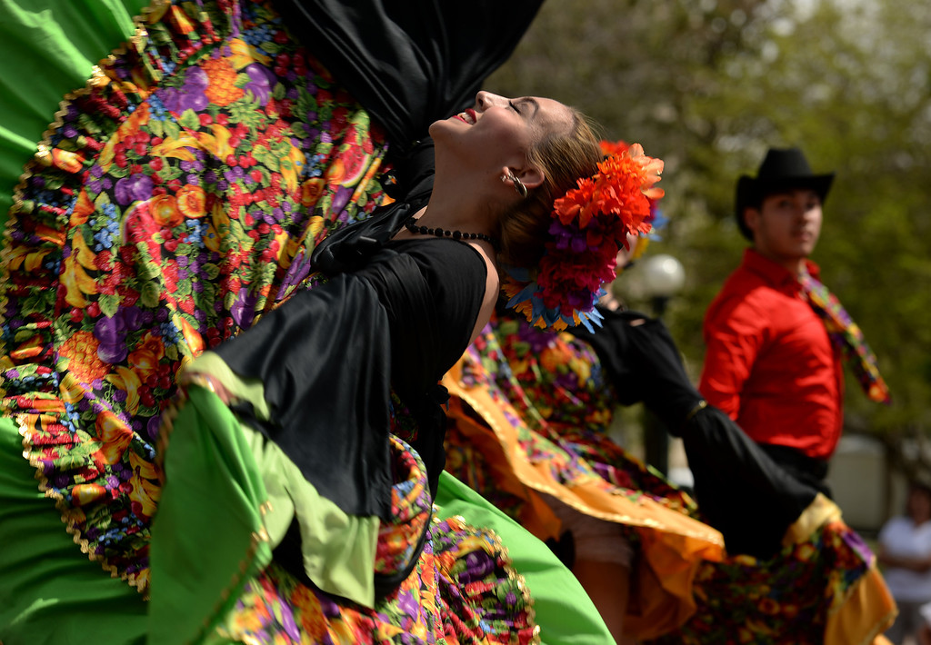 . Alisya Rodriguez performs the Costa de Sinaloa dance with other members of the Fiesta Colorado Dance Company during the Cinco de Mayo celebrations at Civic Center Park in Denver, CO on May 24 2014. (Photo By Helen H. Richardson/ The Denver Post)