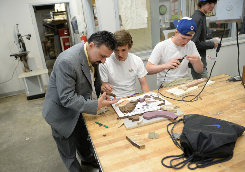 . Columbine High School Principal Frank DeAngelis plans to retire at the end of the school year, Wednesday, April 16, 2014. DeAngelis checks out students work in wood shop as he walks around visiting classrooms talking with students and staff. (Photo by RJ Sangosti/The Denver Post)