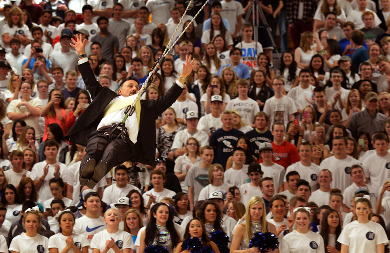 . Columbine High School Principal Frank DeAngelis plans to retire at the end of the school year, April 25, 2014. DeAngelis was honored during the last prep rally of the year, and surprised his students by zip lining across the gym in a tuxedo. (Photo by RJ Sangosti/The Denver Post)