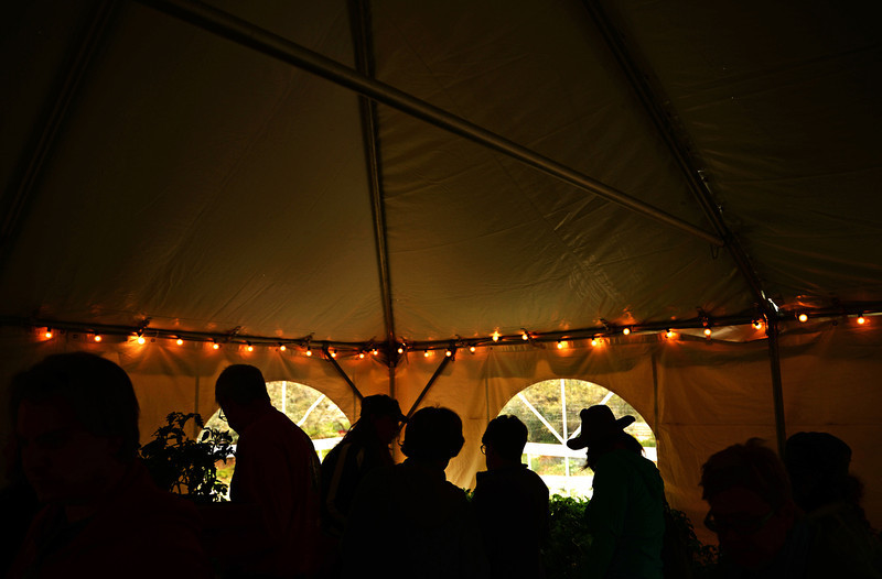 . People crowd into a tent, full of different types of tomato plants, at the Denver Botanic Gardens annual spring plant sale, May 09, 2014. The sale will go through Saturday. (Photo by RJ Sangosti/The Denver Post)