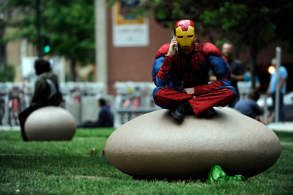 . TJ Giannasca dressed as a hybrid of Spiderman and Iron Man talks on the phone as he takes a break during Denver Comic Con at the Colorado Convention Center in Denver, Colorado on June 14, 2014. (Photo by Seth McConnell/The Denver Post)