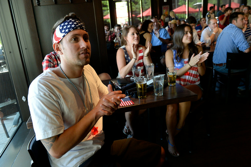 . Gonalo Tedesco with his friends Erin Wiley and Emily Allen watch the USA take on Germany. Fans gather at the Thirsty Lion  June 26, 2014 watch the US play Germany in World Cup competition in Recife.  (Photo by John Leyba/The Denver Post)