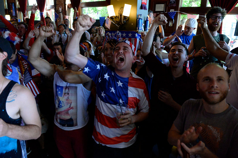 . Brad Young screams out in jubilation after learning Ghana lost to Portugal 2-1 which put the USA in the round of 16 in the World Cup. Fans gathered at Three Lions Pub on Colfax and York St. June 26, 2014 to watch the US play Germany in World Cup competition in Recife.  (Photo by John Leyba/The Denver Post)