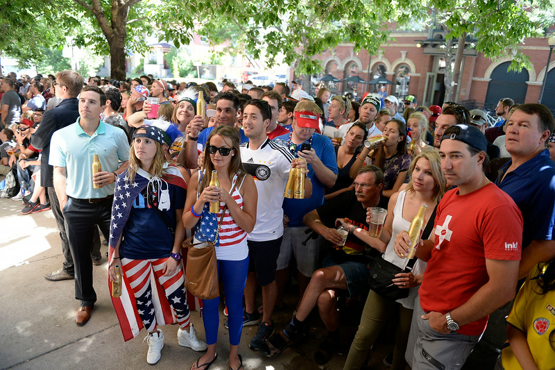 . Fans gather outside on the sidewalk at The Three Lions Pub on Colfax and York St. June 26, 2014 to watch the US play Germany in World Cup competition in Recife.  (Photo by John Leyba/The Denver Post)