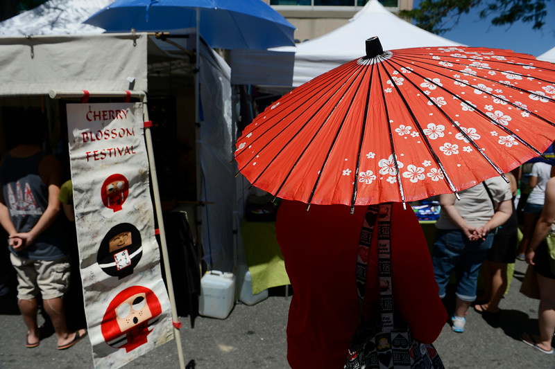 . Japanese parasols were plentiful at the annual Cherry Blossom Festival at the Sakura Square Saturday afternoon, June 28, 2014. The festival, which runs through Sunday 11-4 pm, showcases the Japanese American Culture that includes traditional dances, music, various demonstrations, and food. (Photo By Andy Cross / The Denver Post)