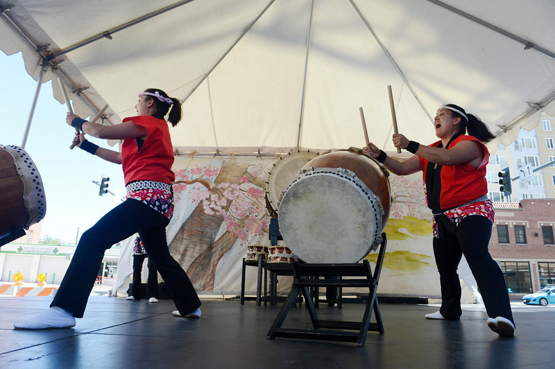 . Shannon Umetani, left, and Keiko Ozaki, right, drummers in the Mirai Daiko Colorado Japanese Drum Ensemble perform with the group during the annual Cherry Blossom Festival at the Sakura Square Saturday afternoon, June 28, 2014. The festival, which runs through Sunday 11-4 pm, showcases the Japanese American Culture that includes traditional dances, music, various demonstrations, and food.(Photo By Andy Cross / The Denver Post)