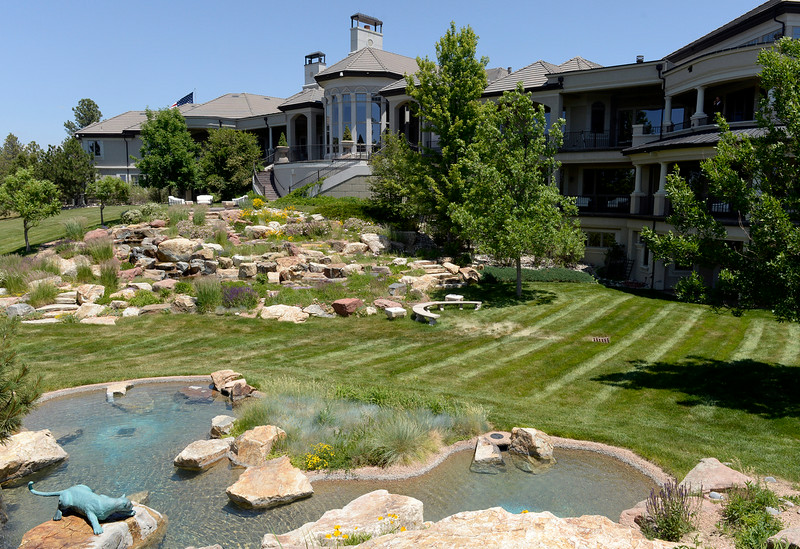 . Visit to the home that has just been placed on the market for $18 million. The 11 bedroom, 24 bathroom home is in Douglas County on Wednesday, July 2, 2014 in Parker, Colorado. Back view of  the home with water features. (Denver Post Photo by Cyrus McCrimmon)
