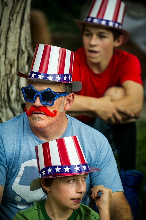 . Todd Cooper with his sons Wyatt Cooper, 11,(front)  and Owen Cooper, 14, (back) for the 5th Annual July 4th Park Hill Parade along 23rd Avenue  on Friday, July 04, 2014 in Denver, CO.  The parade, which ran from Dexter Street to Krameria Street, featured marchers, marching bands, bikers, floats and classic cars.  (Photo by Kent Nishimura/The Denver Post)
