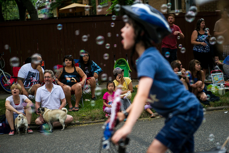. People lined the street for the 5th Annual July 4th Park Hill Parade along 23rd Avenue  on Friday, July 04, 2014 in Denver, CO.  The parade, which ran from Dexter Street to Krameria Street, featured marchers, marching bands, bikers, floats and classic cars.    (Photo by Kent Nishimura/The Denver Post)