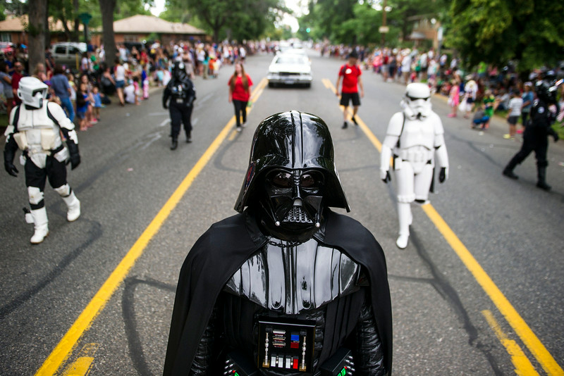 . A person dressed as Darth Vader, flanked by people dressed as Star Wars Imperial Troopers march in the 5th Annual July 4th Park Hill Parade along 23rd Avenue  on Friday, July 04, 2014 in Denver, CO.  The parade, which ran from Dexter Street to Krameria Street, featured marchers, marching bands, bikers, floats and classic cars.    (Photo by Kent Nishimura/The Denver Post)