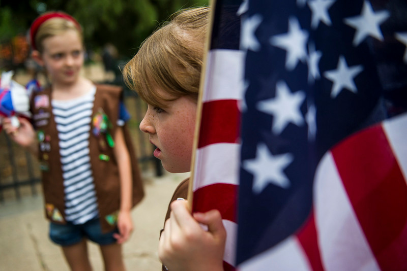 . Elise Kuhn, 8, a member of Girl Scout Troupe 28, holds an American Flag before the start the 5th Annual July 4th Park Hill Parade along 23rd Avenue  on Friday, July 04, 2014 in Denver, CO.  (Photo by Kent Nishimura/The Denver Post)