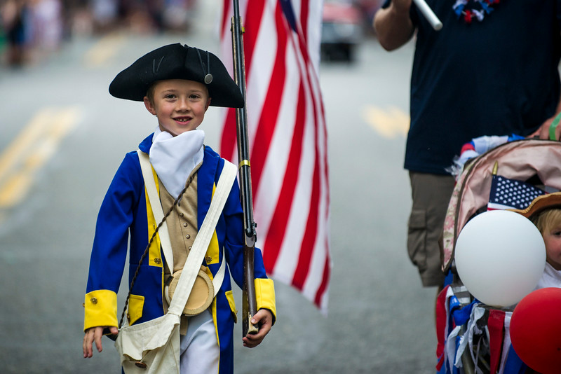 . Dalton Bury, 6, marches in the 5th Annual July 4th Park Hill Parade along 23rd Avenue  on Friday, July 04, 2014 in Denver, CO.  The parade, which ran from Dexter Street to Krameria Street, featured marchers, marching bands, bikers, floats and classic cars.  (Photo by Kent Nishimura/The Denver Post)
